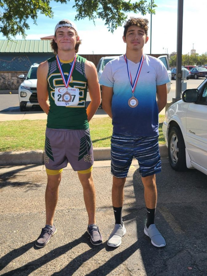 Wolverine medalists from the Mae Simmons cross country meet. (Seniors Trace Goodman and Josh Samaron).