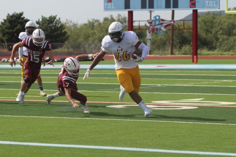 Senior Keshan Holmes looks up the field to score