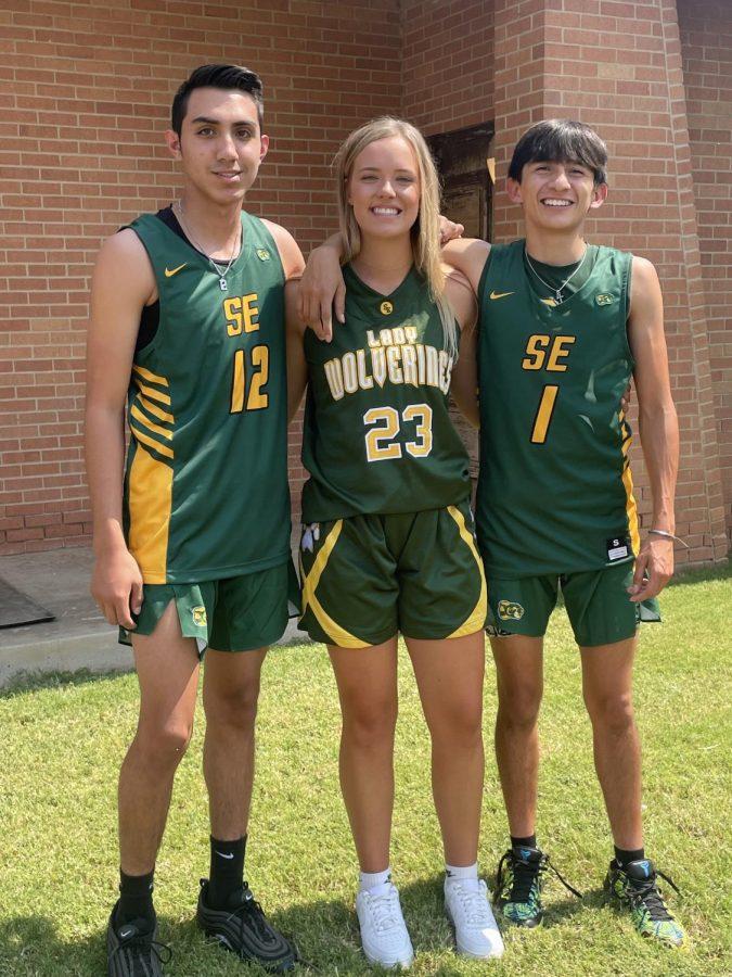 Seniors Kaden Castillo, Sayler Beerwinkle, and Evan Deleon ready for the basketball photoshoot.