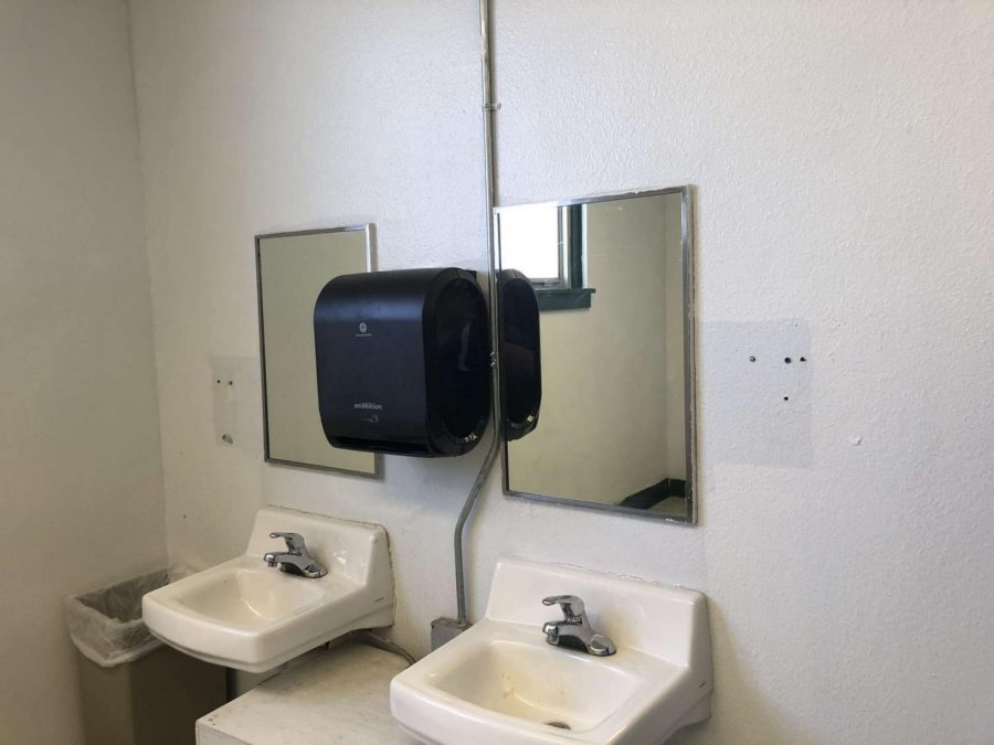 Missing soap dispensers in boys bathroom