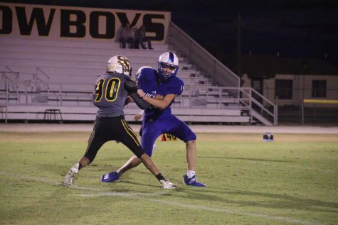 #90, Gavin Gonzales, goes up to block.